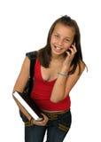 使用妇女年轻人的美丽的移动电话 图库摄影