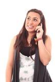 使用妇女年轻人的美丽的移动电话 免版税图库摄影