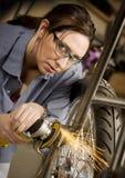 使用妇女的研磨机西班牙摩托车 免版税图库摄影