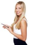 使用妇女的美丽的计算机片剂 免版税库存图片