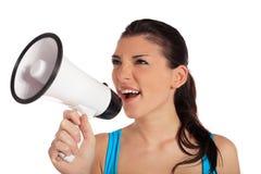 使用妇女年轻人的扩音机 免版税库存照片