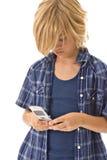 使用年轻人的男孩移动电话 免版税库存图片