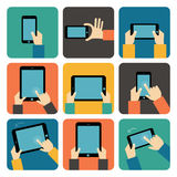 使用手机和片剂个人计算机的手 库存照片