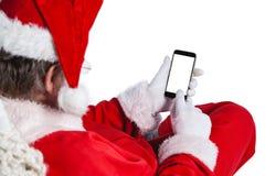 使用手机的圣诞老人 免版税库存图片