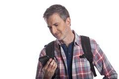 使用手机的游人呼吁Rideshare 免版税库存照片