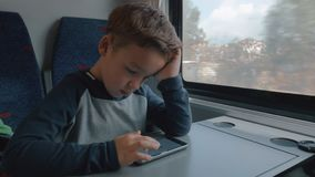 使用手机的男孩在通过转储的火车 影视素材