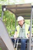 使用挖掘者的人工作者在建造场所 库存图片