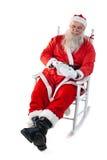 使用数字式片剂的圣诞老人 免版税库存照片