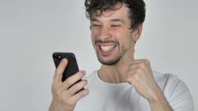 使用智能手机时,为成功激发的年轻偶然人,当 股票录像