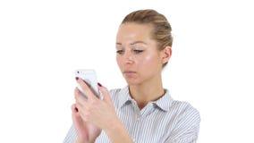 使用智能手机,白色背景的女实业家 股票录像