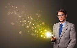 使用有金子闪耀的概念的电话 免版税库存照片