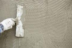 使用湿门面整修技术的ement应用 免版税库存照片