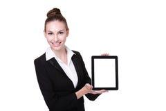 使用片剂个人计算机的女商人或老师 免版税库存图片