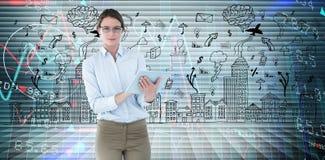 使用片剂个人计算机的女实业家的综合图象 免版税库存照片