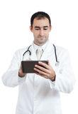 使用片剂的医生在工作 库存图片