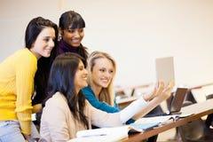使用片剂计算机的学员 免版税图库摄影