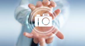 使用现代照相机应用3D翻译的商人 免版税库存图片