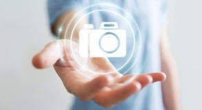 使用现代照相机应用3D翻译的商人 库存照片