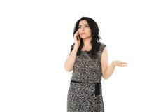 使用电话的少妇 免版税库存照片