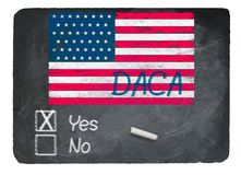 使用白垩的是DACA概念在板岩黑板 图库摄影