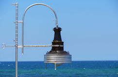 使用的典型的灯在天空的小船背景 图库摄影