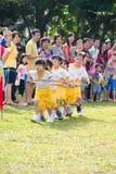 使用的孩子赛跑配合 库存照片
