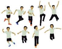使用的小学生跳跃和 免版税库存照片