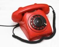 使用的老红色电话 库存图片