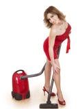 使用真空妇女年轻人的擦净剂 库存图片