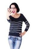 使用移动电话的青少年的女孩,查出在白色 库存图片