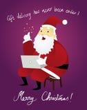 使用Laptop_Christmas的滑稽的圣诞老人 免版税库存照片