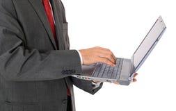 使用膝上型计算机的生意人 库存照片