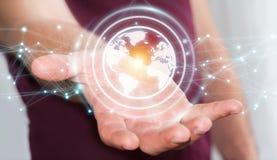 使用行星地球网络球形3D翻译的商人 库存图片