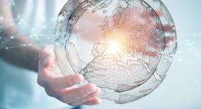 使用行星地球网络球形3D翻译的商人 免版税图库摄影