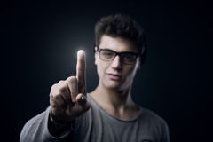 使用触摸屏接口的少年 免版税图库摄影