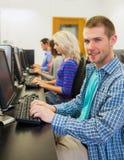 使用计算机的学生在计算机室 免版税图库摄影