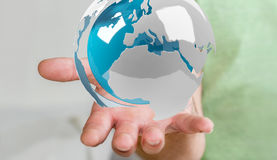 使用飞行白色和蓝色3D翻译地球的商人 库存照片