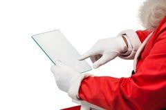 使用玻璃的圣诞老人 免版税库存图片