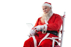 使用玻璃的圣诞老人 库存图片