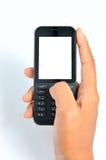 使用Handphone的被隔绝的手 免版税库存照片