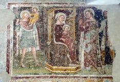 使登基的玛丹娜和孩子、圣徒克里斯托弗,凯瑟琳、乔治和崇拜者骑士 免版税库存图片