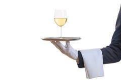 侍者在盘子的服务酒 免版税库存图片
