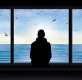 供以人员剪影在看湖认为的窗口 库存照片