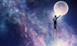 供以人员得到月亮 混合画法 免版税图库摄影