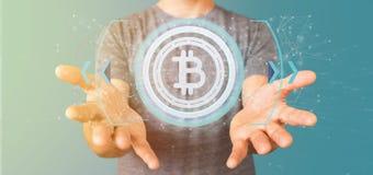 供以人员拿着在圈子3d翻译的技术Bitcoin象 免版税库存照片