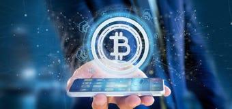 供以人员拿着在圈子3d翻译的技术Bitcoin象 免版税库存图片