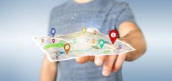供以人员拿着在地图的一个3d翻译别针持有人 免版税图库摄影