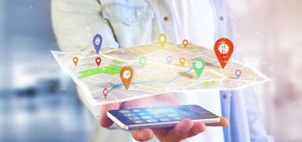 供以人员拿着在地图的一个3d翻译别针持有人 免版税库存图片