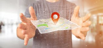 供以人员拿着在地图的一个3d翻译别针持有人 图库摄影