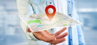 供以人员拿着在地图的一个3d翻译别针持有人 库存图片